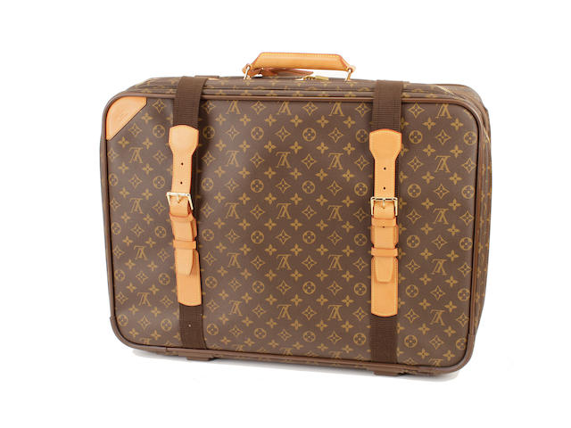 A Louis Vuitton brown and tan monogram suitcase