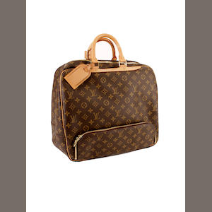 A Louis Vuitton brown and tan leather monogram square form hold-all
