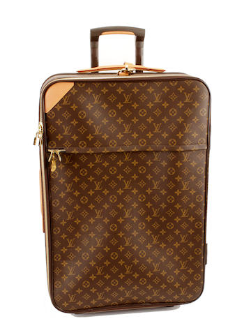A large Louis Vuitton brown and tan monogram rolling suitcase