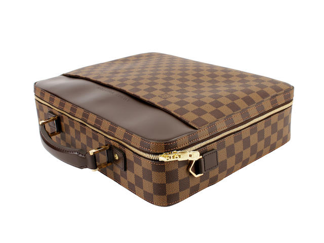 A Louis Vuitton damier leather laptop case