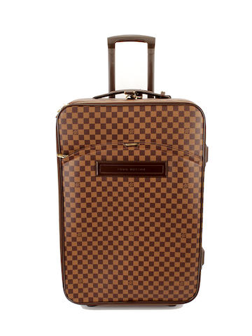A large Louis Vuitton damier rolling suitcase