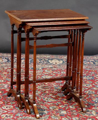 A nest of three mahogany side tables