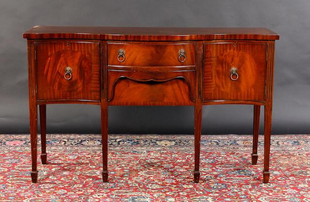 A Hepplewhite style mahogany sideboard