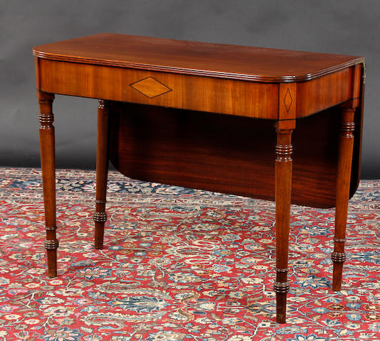 A Victorian mahogany tea table