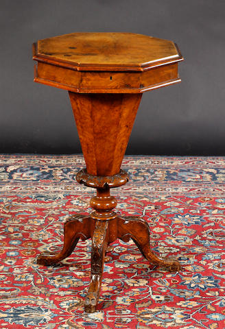 A Victorian walnut trumpet shaped sewing table