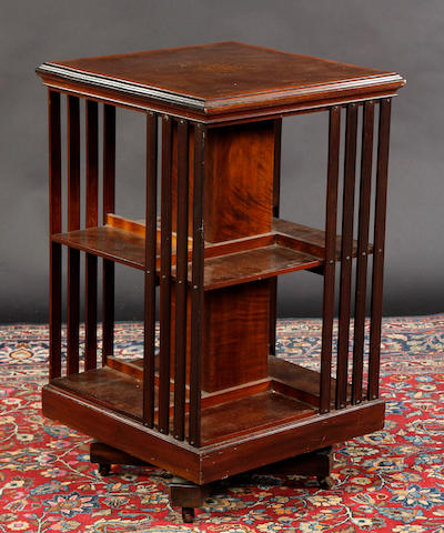 An Edwardian mahogany and satinwood banded revolving bookcase