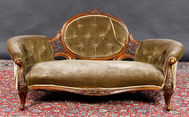 A Victorian carved walnut framed three seater sofa
