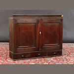 A George III mahogany hanging wall cabinet In need of restoration