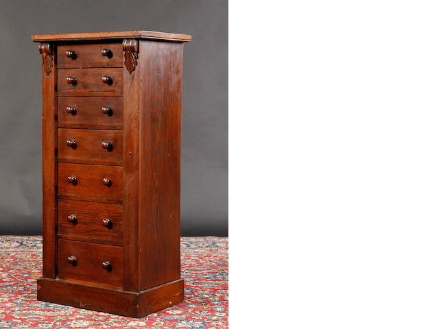 A Victorian oak Wellington chest