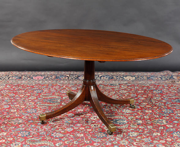 A 19th century mahogany breakfast table