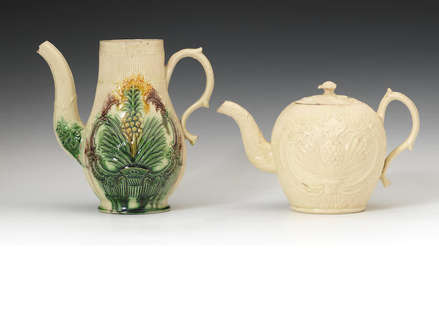 A creamware coffee pot and tea pot with cover both with moulded pineapple panels