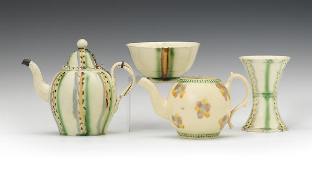 A teapot and cover, a small bowl, a vase and another teapot, circa 1760-65