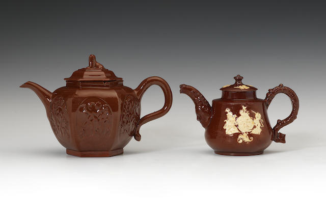 A small Staffordshire glazed redware armorial teapot and cover, circa 1740