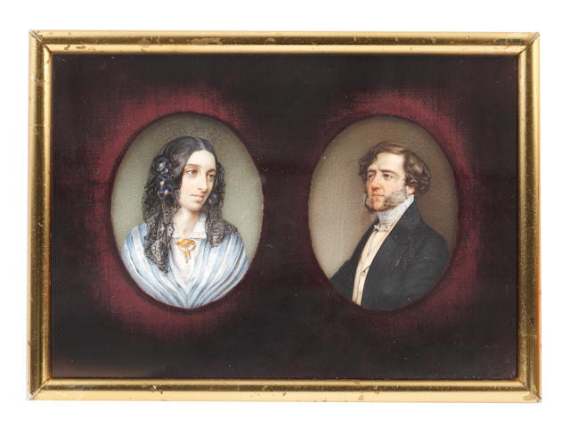 English School, circa 1840 A pair of portrait miniatures of Amantine Lucile Aurore Dupin ('George Sand'), later Baroness Dudevant (1804-1876) and her husband, François Casimir, Baron Dudevant (1795–1871); the former, wearing white dress with lace collar, gold brooch, a blue and white striped shawl draped about her, her dark hair parted and upswept beneath a black lace Spanish-style veil, dressed with black orchids; the latter, wearing black coat, buff waistcoat, white chemise, blue and white embroidered stock and necktie, his brown hair parted to one side