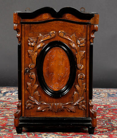 A 19th century Dutch wall hanging cabinet