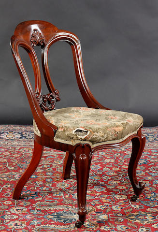 A Victorian balloon back chair