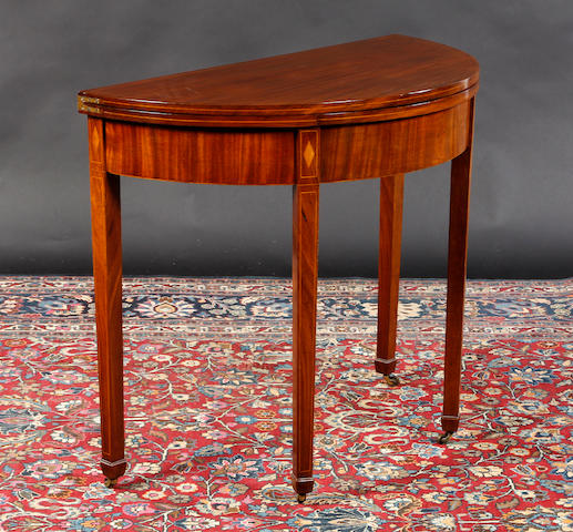 A 19th century demi-lune gate leg tea table