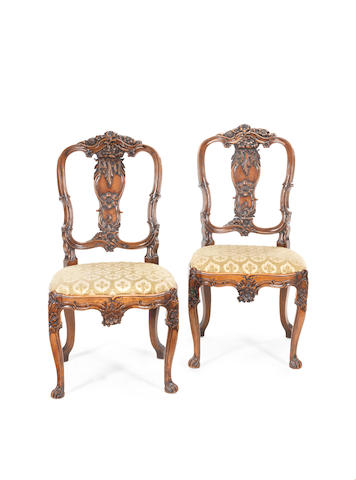 A pair of Rococo carved walnut side chairs