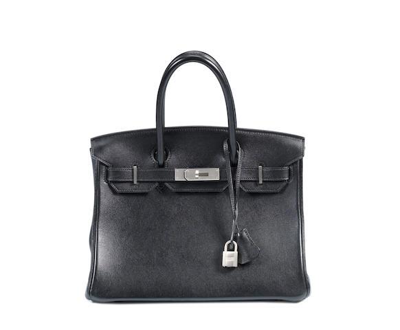 An Hermès black leather Birkin bag with matte hardware,