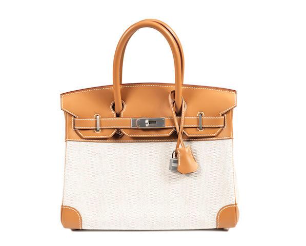 An Hermès tan leather and cream toile Birkin bag, 2000