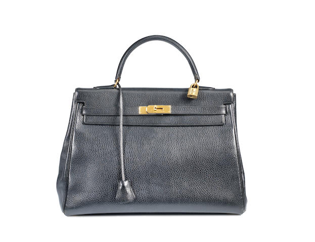 An Hermès black taurillon leather Kelly bag, 1993