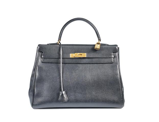 An Hermès black taurillon leather Kelly bag,