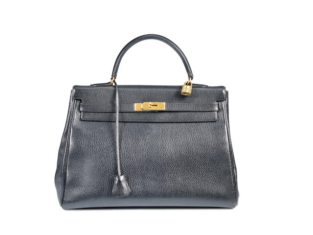 An Hermès black taurillon leather Kelly bag,