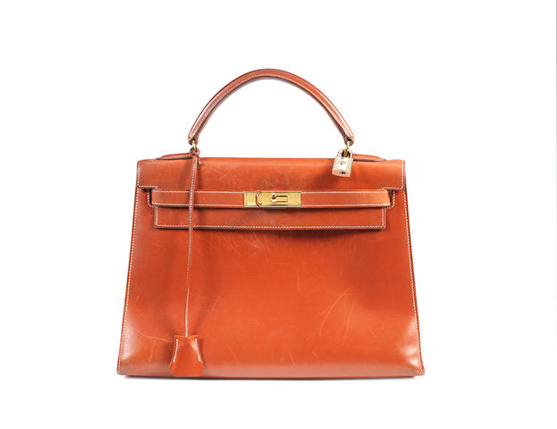 An Hermès rust red box leather Kelly bag, 1998