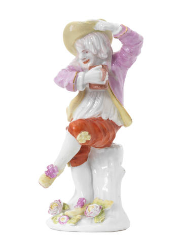A Meissen figure of a drunken peasant, 18thC with later decoration
