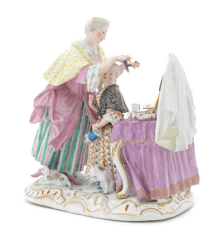 A Meissen group of a mother and child at a dressing table, circa 1764-73