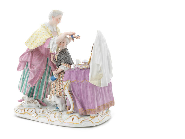 A Meissen figure group of mother and child at a dressing table, late 18thC