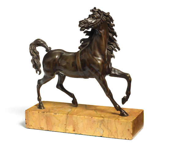 A French 18th century bronze model of a prancing horse