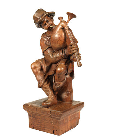 A Flemish 18th century carved oak figure of a bagpipe playerafter a model by Giambologna (1529-1608)