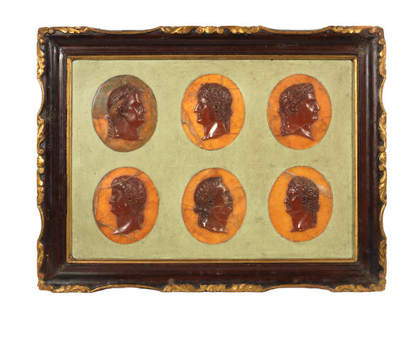 A set of 12 agate profile medallions of Roman Emperors