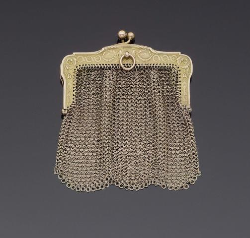 A yellow metal small chain mail purse unmarked, only ring attachment marked