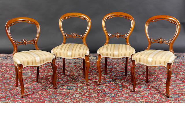 A set of four Victorian walnut salon chairs