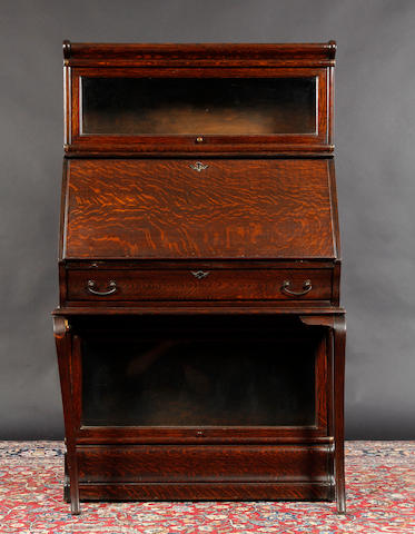 An unusual early 20th century oak sectional bureau bookcase