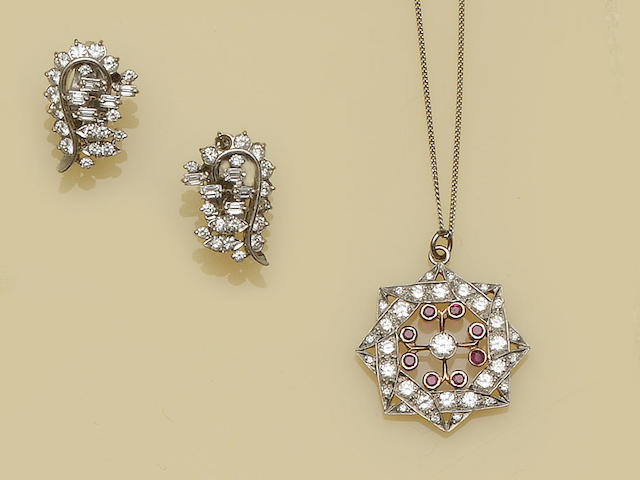 A diamond pendant and a pair of diamond earclips (2)