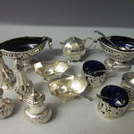 A pair of oval Victorian silver salts,  by Nathan and Hayes  Birmingham 1892,  (12)