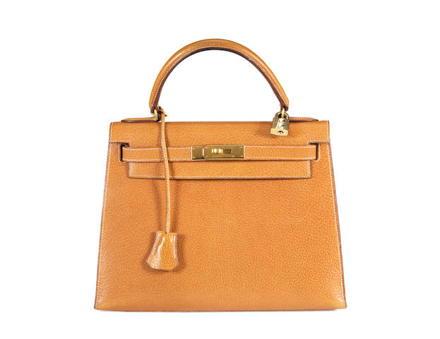 An Hermès tan togo leather Kelly bag with white stitching, 1994