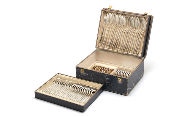 An early 20th century Continental silver table service of flatware part contained in a box, retailed by Emile Anthony & Wolfers of Antwerp, marked 800, also with French import marks