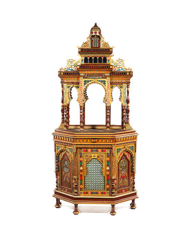 A late 19th/ early 20th century parecl-gilt and polychrome decorated Moorish style architectural cabinet