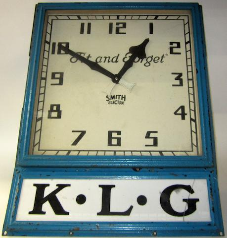 """A KLG """"Fit and Forget"""" wall-mounting garage clock, by Smith,"""