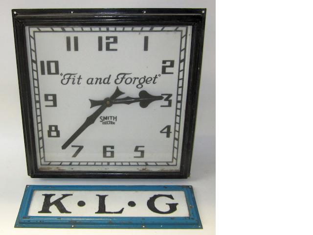 "A KLG ""Fit and Forget"" wall-mounting garage clock, by Smith,"