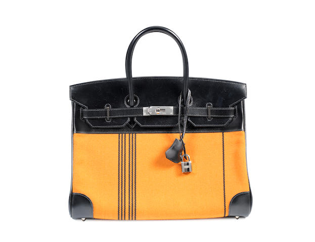 An Hermès black leather and orange and black striped toile Birkin bag, 2006