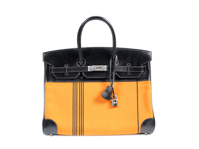 A Hermes orange and black leather and toile Birkin bag