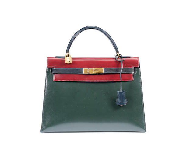 An Hermes navy and burgundy bi-colour leather Kelly bag