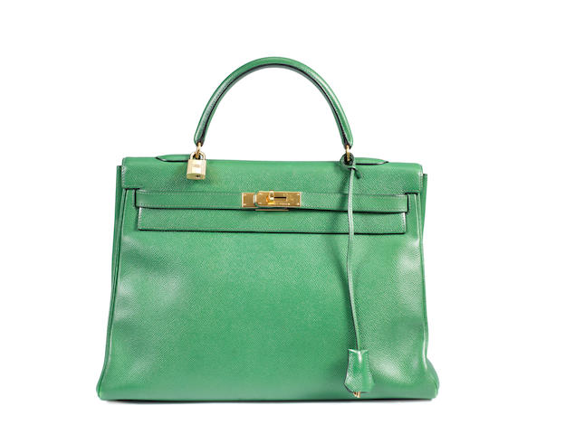An Hermes green leather Kelly bag, clutch, agender and pen case