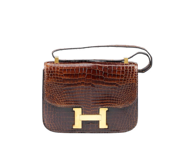 An Hermès brown crocodile Constance bag, 1972