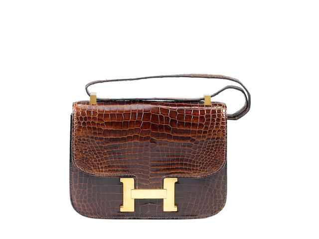 An Hermès brown crocodile Constance bag